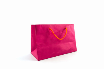Blank pink paper shopping bag.