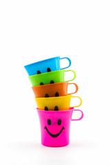 Happy smiley faces mug in row.
