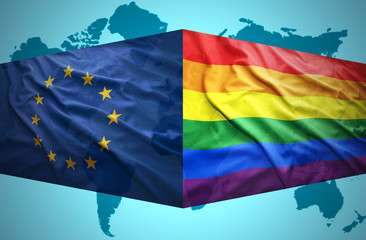 Waving  European Union and Gay flags