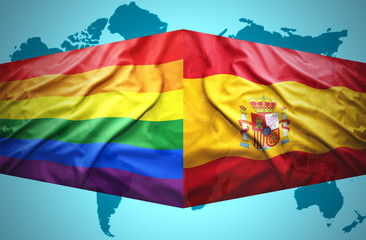 Waving Spanish and Gay flags