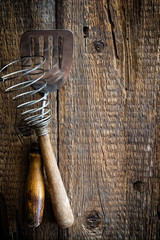Culinary background with kitchen utensils on wooden table