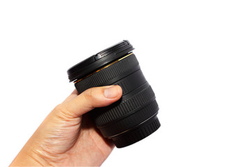 Man hand holding a wide angle lens isolated on white background.