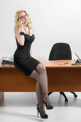 young business woman sitting at the desk