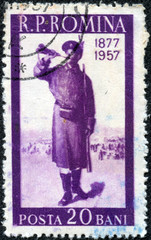 stamp printed in Romania shows soldier with a horn