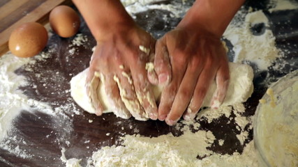 Closeup of woman making dough