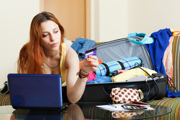 woman reserving hotel online in the internet