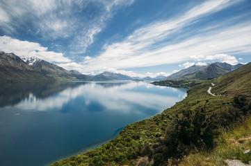 Reflection of the mountain range on Lake Wakatipu, New Zealand