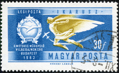stamp printed in Hungary shows Icarus Air