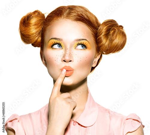 Joyful teen girl with freckles, funny hairstyle choosing - 68865203
