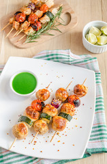 Grilled chicken skewers with zucchini and cherry tomatoes