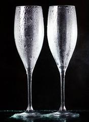 champagne glasses on black spray