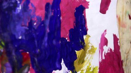 child painting with gouache at paper