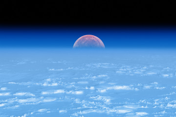 Moon eclipse behind the fuzzy Earth's atmosphere. No stars.