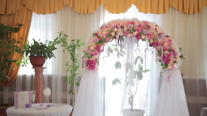 Wedding Arch with flowers indoor