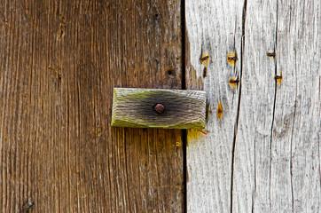 Wooden latch on a wooden door