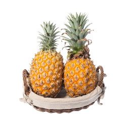 two Pineapples on wooden grunge background