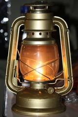 a glowing hurricane lamp