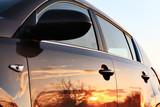 car sunset reflection