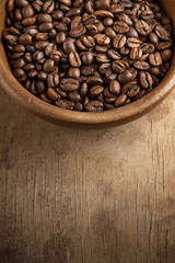 coffee beans on wood bowl
