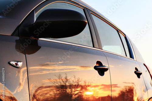 car sunset reflection - 68869279