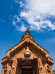 Buddhist temple made of Laterite with clear blue sky, Thailand