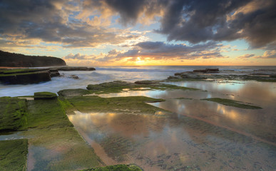 Rising sun on  Turrimetta coastline Sydney