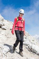 Female climber descending a mountain trail