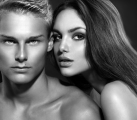 Sexy couple. Young man with his girlfriend. B&W portrait