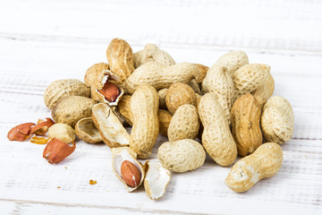 peanuts on a white wooden background