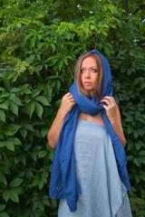 Girl in a blue cape