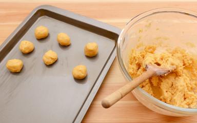 Balls of cookie dough on a baking sheet