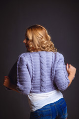 Girl in a knitted violet cardigan