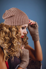 Profile of dbond girl in a warm hat