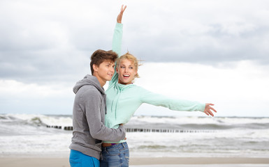 Couple Enjoying Romantic autumn beach
