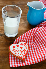 glass of milk and cookies in the shape of heart