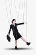 Businesswoman hanging on strings
