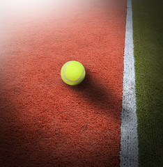 Tennis ball on court grass play game background