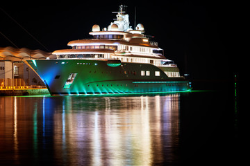 Luxury yacht moored in the harbor next to the cruise terminal
