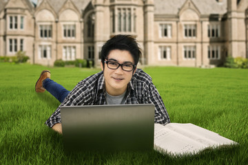 Male student studying outdoors 1