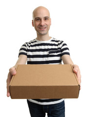 Smiling delivery man holding the box