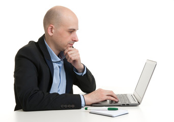 Busy businessman working on his laptop