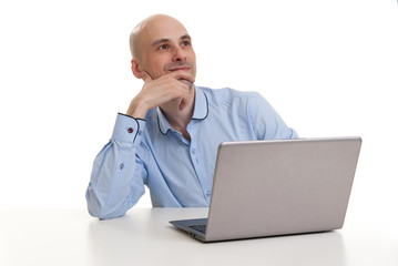 relaxing bald man with laptop computer