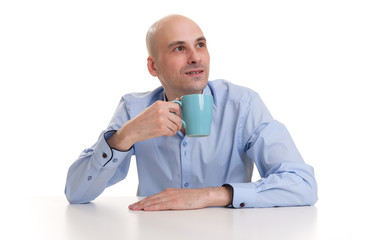 man drinking a cup of coffee or tea