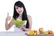 Pretty woman eats a bowl of salad 2