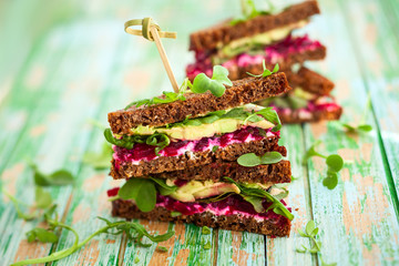 beet,avocado and arugula sandwich