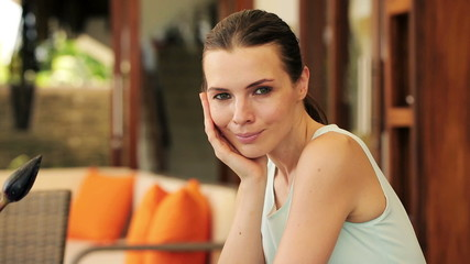 Portrait of young happy beautiful businesswoman by table at home