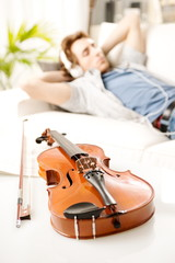 Musician relaxing at home