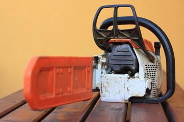 Big orange chainsaw with protective chain guard