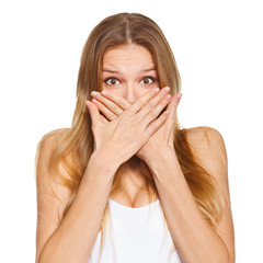 Surprised happy woman covering her mouth with hand. isolated