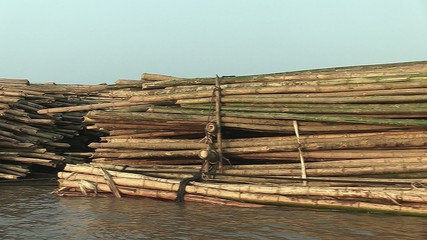 Side of bamboo rafts on the mekong towed by a boat (1)
